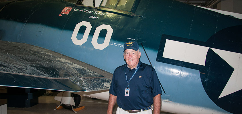 RADM James Flatley poses with one of his father's planes from WWII. © 2016 Audra L. Gibson. All Rights Reserved.