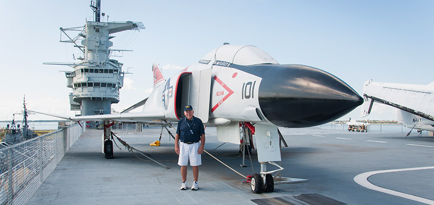 RADM Flatley standing in front of an F4 on the deck of the Yorktown, the equipment he flew in Vietnam. © 2016 Audra L. Gibson. All Rights Reserved.