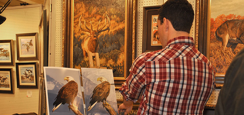 SEWE Painter, Ryan Kirby, takes a step back to check his source in the Quick Draw Event. © 2015 Audra L. Gibson