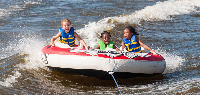 Pure joy tubing at Camp Happy Days. © 2014 Audra L. Gibson. All Rights Reserved.