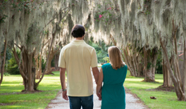 A Charleston vacation photographer shoots a couple's portrait in Hampton Park.