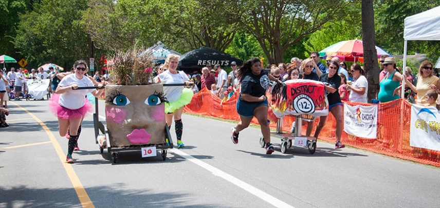 Teams race head to head in the Charleston Bed Race.