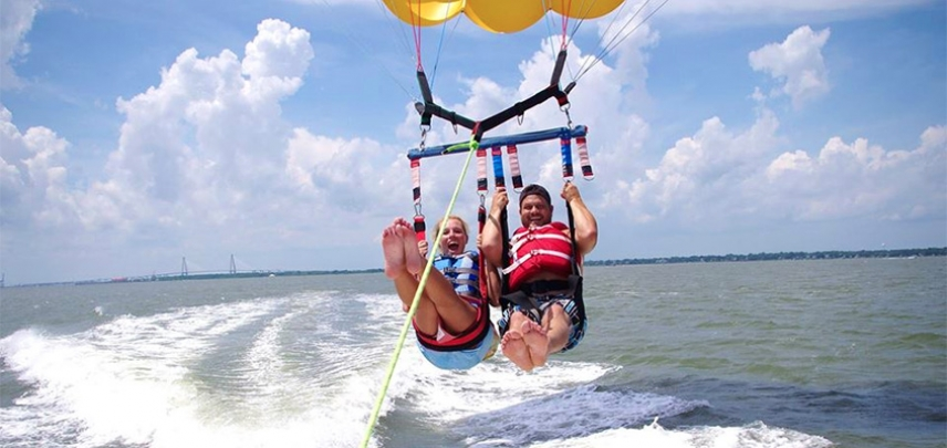 Parasailing with the Ravenel Bridge in the background.