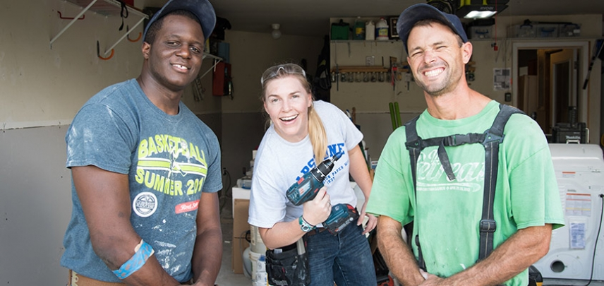 Don, Audra, and Butler taking a break after finishing drywall in the garage.